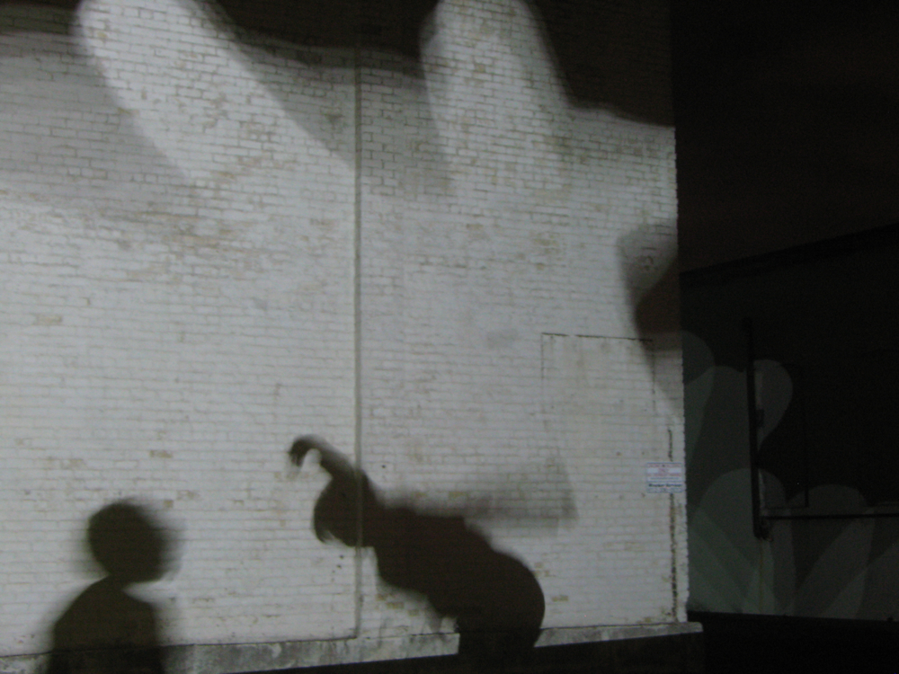 Andrea Steudel's mobile shadow puppet projection project on the Thorp building. http://tylerstefanich.com/clients/northernlights/programs/aov/steudel/