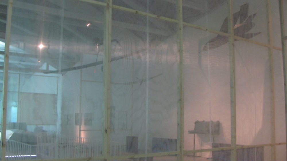 """""""Walls"""" of doubled scrim materials divide the space at LABoral but allow for a more synoptic gaze of the exhibition."""