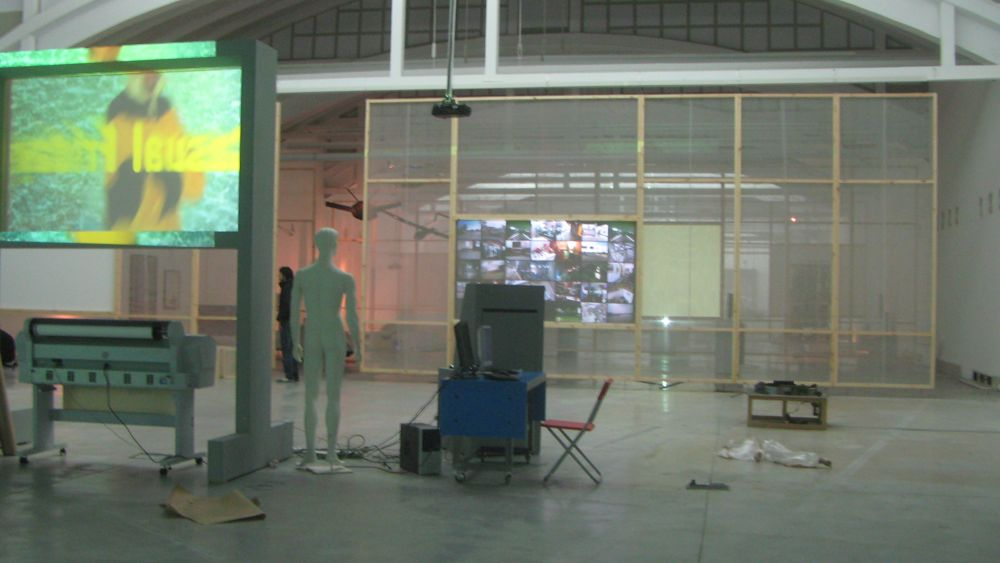 """Looking from the back of the gallery past """"Invisible Threads"""" toward """"Tracking Transience"""""""
