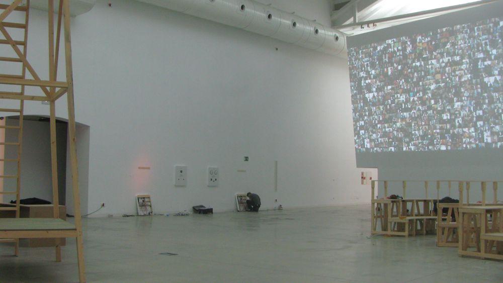 """Piotr Szyhalski's """"Labor Camp Study Room D"""" (far wall)"""