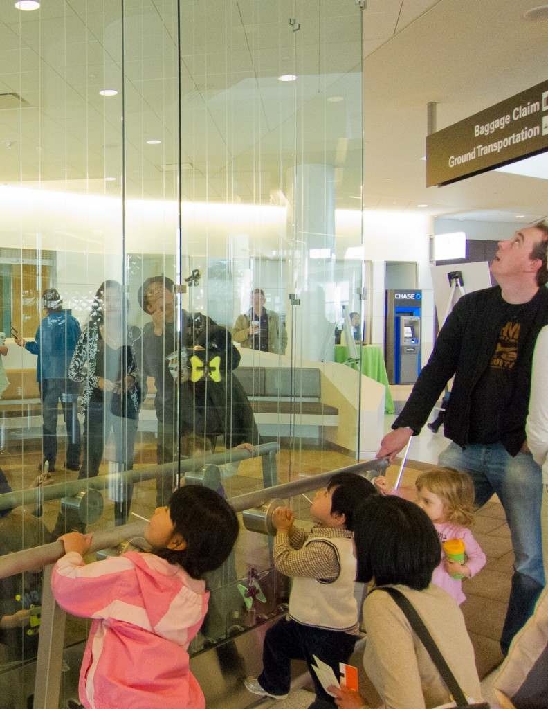Young visitors at Charles Sowers' hands-on interactive Butterfly Wall