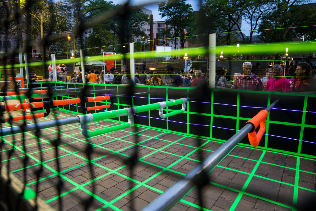 Chris Pennington, Rob Clapp, John Grider, and David Pitman, Tron Human Foosball, Peavy Plaza, Northern Spark 2015. Photo: Shawn Orton.