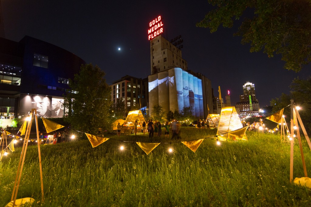 Marina Zurkow with Valentine Cadieux, Aaron Marx, and Sarah Petersen, Making the Best of It: Dandelion, West River Parkway, Northern Spark 2016;  Keri Pickett, Jason Takahashi, and Charlie Thayer, Against the Grain, Chicago Mall, Northern Spark 2016; Joshua McGarvey and Heckadecimal, Ice Fall—Feel The Change, Mill Ruins Park and Gold Medal Silos, Northern Spark 2016. Photo: Dusty Hoskovec.