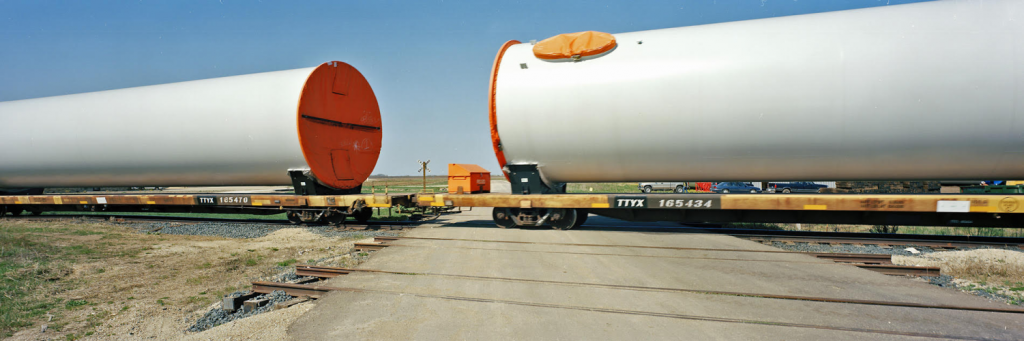 Stuart Klipper, Wind turbine tower sections being brought in for assembly. Central Minn., 2010